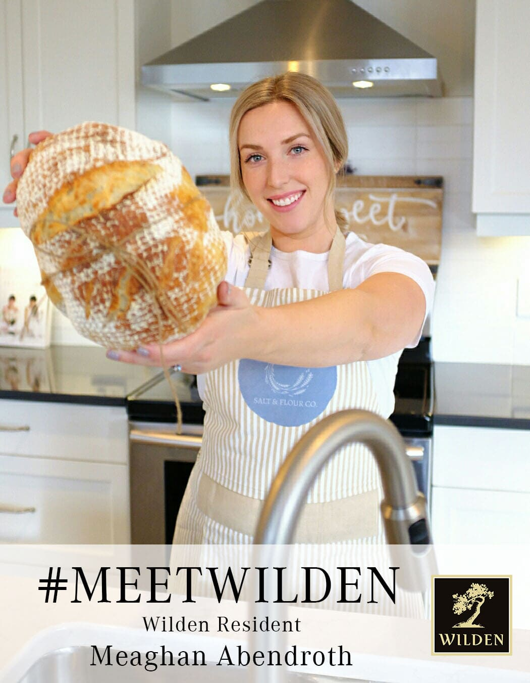 Meaghan Abendroth holding up organic sourdough bread image