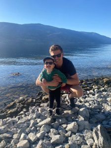 Kayla Bordignon's husband with daughter at lake image